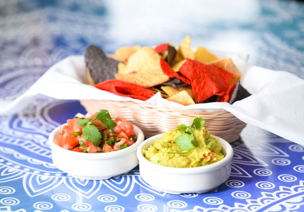 A side of house-made chips with salsa and guacamole are a great way to start your meal at Ocho Cinco Cantina in Warrensburg, NY.